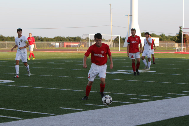 Ethan Anderson advances the ball down the field in the Rockets' 2-0 loss against Andover Central.