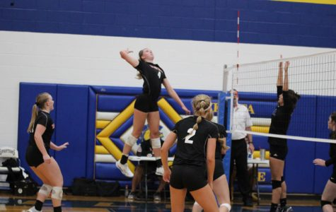 Senior Gracie Van Driel goes up for a block in the Rockets victory over Collegiate on August 28.