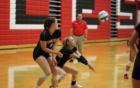Aspen Goetz and Emily Adler try to dig out a return from Andover Central on Thursday, September 6. The Rockets defeated the Jaguars 25-12, 25-21