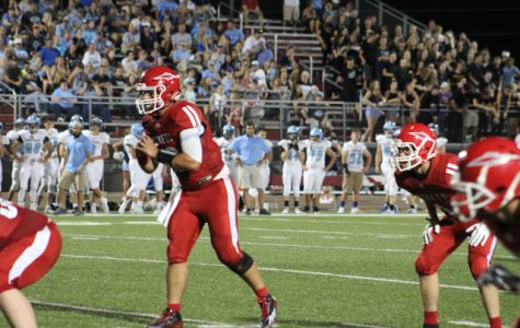 Quarterback Tyce Carlson stands back in the shotgun, waiting to receive the snap. Carlson threw for 378 yards and three touchdowns in the Rockets' 22-18 loss to Clearwater. Photo courtesy of Amy Bischler
