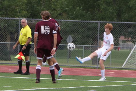 Caden Dinkel kicks the ball in against Buhler in the fifth place game of the Campus/Goddard Tournament. The Rockets lost 4-1, with Dinkel scoring their lone goal.