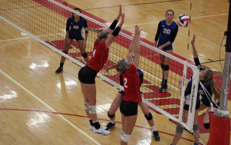 Gracie Van Driel and Breckyn Myers go up for a block against Collegiate on Tuesday, September 4. The Rockets defeated the Spartans 25-11 and 25-13.