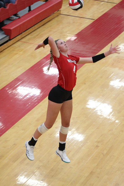 Gracie+Van+Driel+hits+a+serve+against+Collegiate+on+September+4.+Van+Driel+was+a+four-time+all-state+selection%2C+three-time+league+MVP+and+two-time+state+champion.