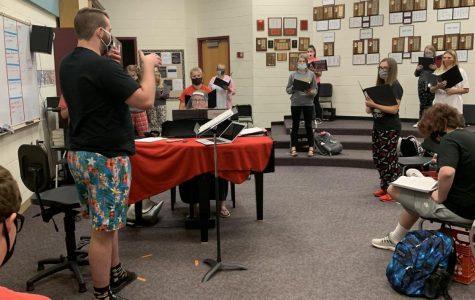 New choir teacher Christopher Kurt instructs the Rocketaires.