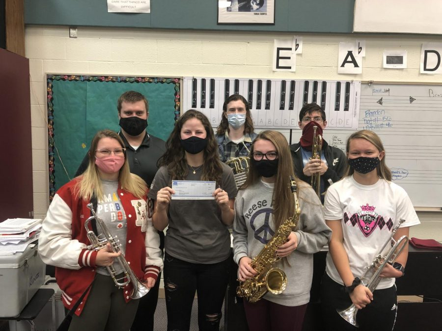 The Rose Hill High School band program received a $500 check from Charlie