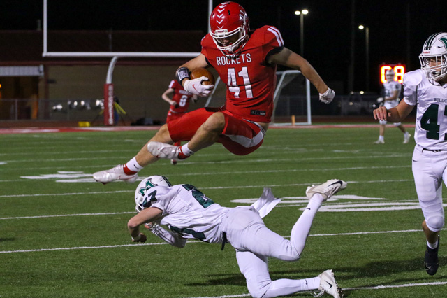 Kale Kochick leaps over a Mulvane defender in the Rockets playoff victory.